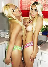 Two Blonde Shemales playing and stripping in the kitchen
