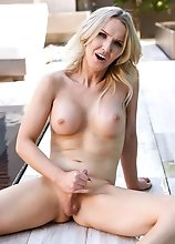 Watch Kayleigh Coxx posing near the pool, fucking her tight ass with a dildo and stroking her cock until she cums!