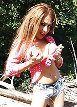TS TaniaQ stroking her Long Hard Tool outdoors