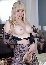 Jesse's tight fitted body lace could barely contain her huge throbbing erection that wants to cum all over you!
